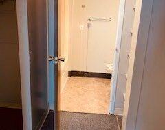 Bedroom Door Looking Into Bathroom